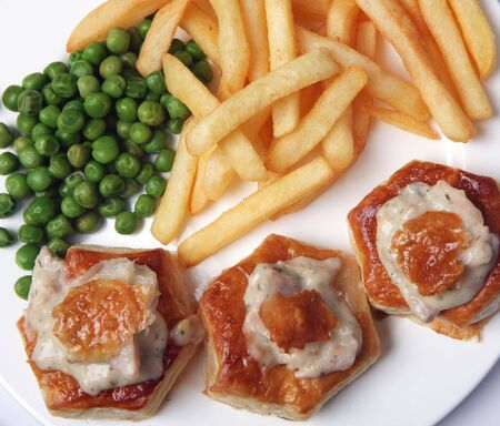 leftovers: Turkey sauce vol au vents with fries and peas, one of many cheap dishes that can be made from festive leftovers.