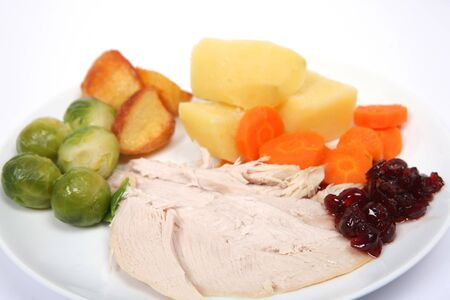 Close-up view of a traditional turkey Christmas dinner on a white background photo