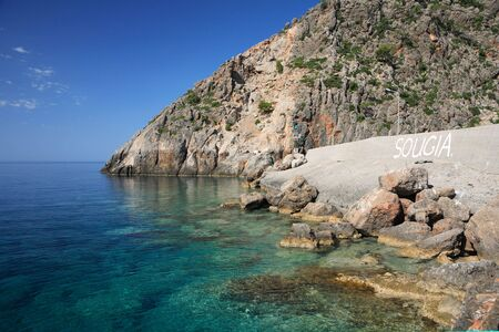 tectonics: The harbour wall and cliffs at Sougia, south-west Crete. Erosional marks on the cliffs show clearly that the sea level has fallen as Crete has been  uplifted by the tectonic effects of North Africa and Europe colliding. Stock Photo