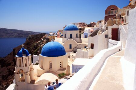 The famous blue and white churches at Oia village on Santorini (Thira), Greece Stock Photo - 3597001