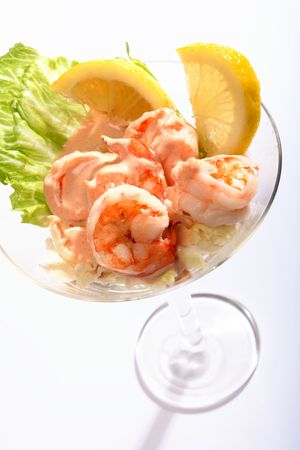 A traditional prawn cocktail, macro from above, in a martini glass photo