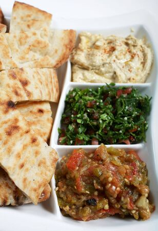 mediterrean: Traditional Arab or Mediterranean mezze with Turkish flat bread. From the front: babaganoush, tabouleh and hummus