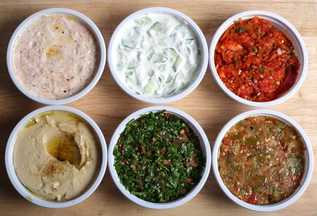 appetiser: View looking down on six Arab or Turkish mezzes in  Stock Photo