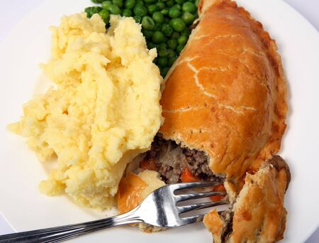 mincing: Minced beef meat pie with mashed potato and peas, viewed from above