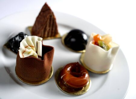 A plate of petits fours, shallow depth of field.