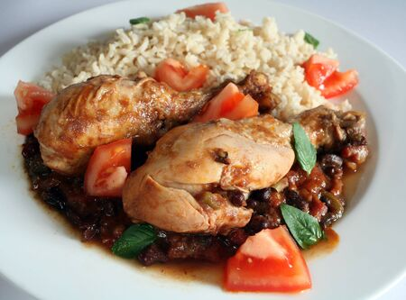 cuban: Traditional Cuban chicken drumsticks in black bean and tomato sauce, served with brown rice.
