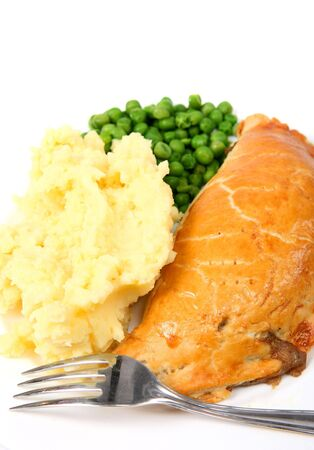 meat pie: A meal of a pasty-type meat pie with mashed potatoes and peas, close-up Stock Photo
