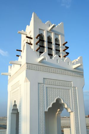predecessor: An ornamental wind tower in Doha, Qatar. The towers made the air circulate, acting as a predecessor to modern air-conditioning. Stock Photo