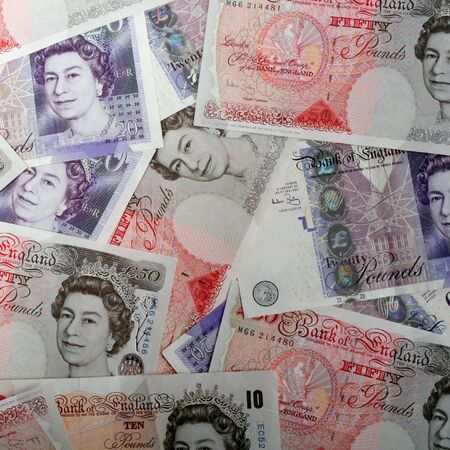 An arrangement of high value British banknotes, close-up view.