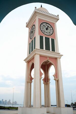 The 1960s Clock Tower outside the Emiri Diwan palace in central Doha, Qatar. The old tower, dating from the early days of Qatari independence, was one of the citys first landmarks. photo