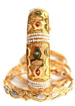 A gold bracelet with small natural Gulf pearls and inlaid with enamel, in the Arab style. photo