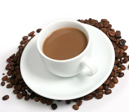 A cup of coffee with milk on a pile of coffeebeans Stock Photo - 4084424
