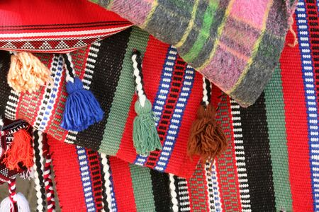 saddle camel: Close-up view of the patterns on camel saddle blankets, used to provide cushioning for the rider and to add a touch of elegance. These blankets were actually in use. Stock Photo