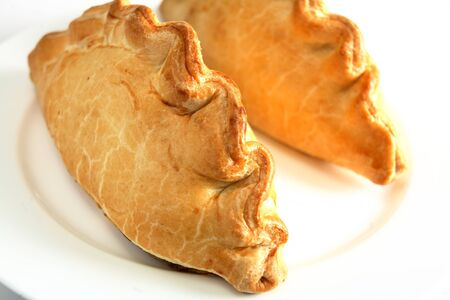 filled: Traditional Cornish pasties; filled with meat, onion and potato, these have become a favourite snack across Britain.
