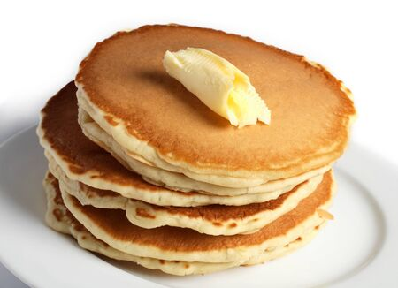 dollop: A pile of pancakes with a dollop of butter