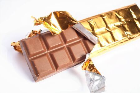 horizontal bar: A bar of chocolate with the gold foil pulled open Stock Photo