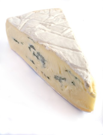 brie: A wedge of Cambozola soft blue-veined brie cheese on a white background Stock Photo
