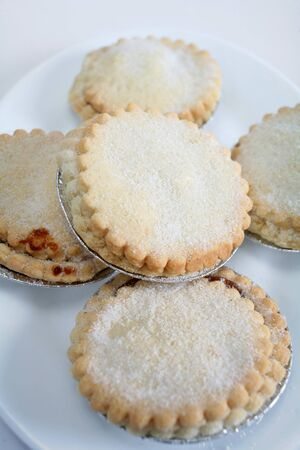 festive food: Sweet mince pies, a traditional rich festive food. Stock Photo