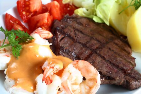 rump steak: A surf and turf meal of steak and prawns Stock Photo