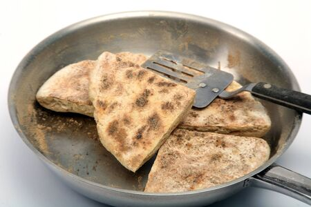 bread soda: Baking traditional Irish soda farl, a soda bread baked on a griddle or in a dry iron pan and served as a quick teabread with butter and jam. It is very similar to Scottish griddle scones, though they are cooked with a little grease. Farl means quarter a