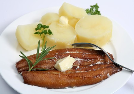 kipper: A kipper, or smoked herring, served with boiled potatoes and a knob of butter.
