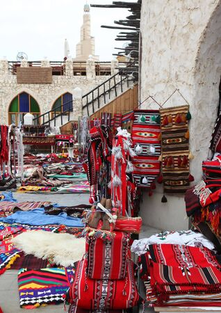 souq: Traditional Arab textiles on sale in Souq Waqif, Doha, Qatar.