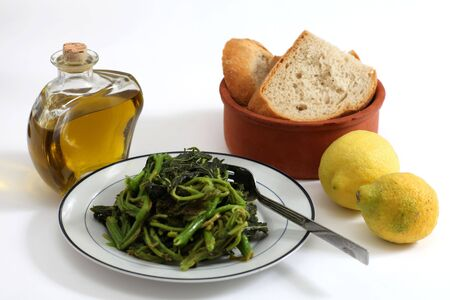 green's: Cretan vlitsa, asparagus flavoured wild greens which are boiled and then tossed with olive oil and lemon. The dish remains popular in greek villages. Stock Photo