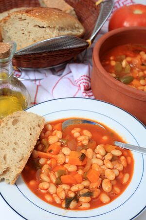 White bean soup, said by one authority to be the soup that feeds Greece, made with dried beans, tomato, carrot, celery, olive oil and onions. Stock Photo