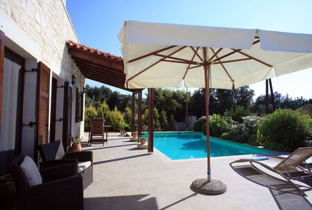Patio and pool of a Greek holiday villa in the Aegean island of Crete photo