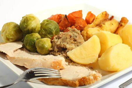 opvulmateriaal: Een maaltijd van geroosterde kalkoen met alle toeters en bellen - spruitkool, geroosterde zoete aardappelen, geroosterde pastinaak vulling en gekookte aardappelen