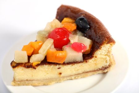 Close-up view of a fruit topped sponge cake photo