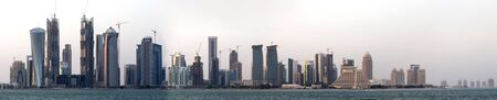 than: A view of the high-rise district of Doha, Qatar, still under construction (there are more than 40 cranes in this photo) on the evening of September 26, 2009. The image is a stitched panorama