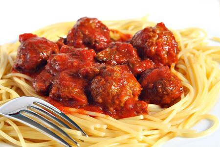 homemade style: Closeup on a plate of spaghetti with meatballs in tomato sauce in the Italian style, a tasty homemade dish