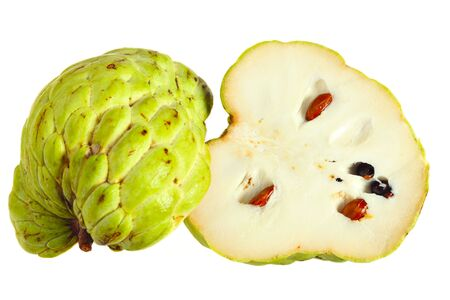 annona squamosa: A custard apple, or sugar apple, sliced in half to show both the inside and the outside, isolated on white. Species Annona squamosa. Stock Photo