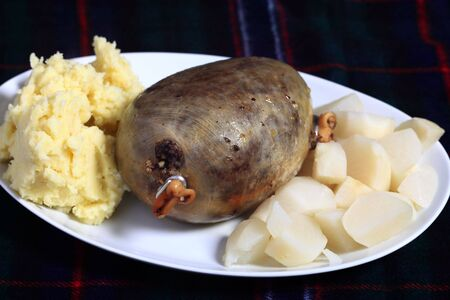 offal: A cooked haggis with diced turnips and mashed potatoes - the traditional