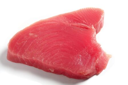 Bluefin tuna (blue ahi tuna) steak, over white. This is regarded as the finest tuna and is the kind used in sushi.