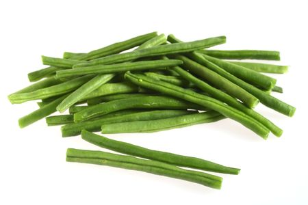 haricot vert: A heap of tender green haricot beans over a white background