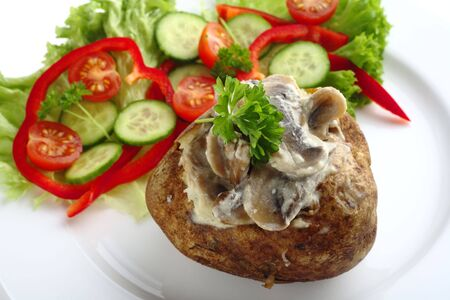 russet potato: A baked potato stuffed with mushroom in a cream sauce, served with a salad