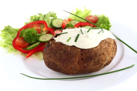 russet potato: A baked russet potato, topped with cream cheese and chives and served with a salad