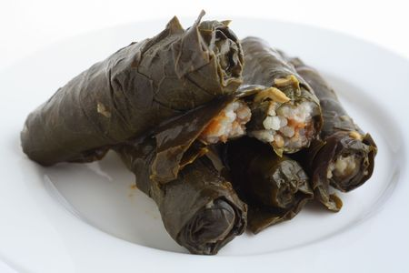 Stuffed vine leaves, or dolmathes, a traditional mediterranean/ottoman empire dish of rice and finely chopped vegetables neatly wrapped in a vine leaf. Stock Photo - 6370647