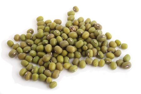 mung: A view of a pile of mung beans from the side