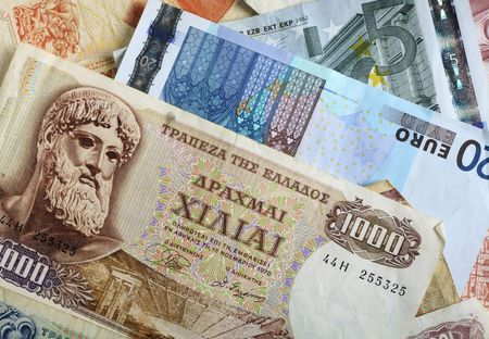 A mixture of old Greek drachma banknotes and euro notes that succeeded them. photo