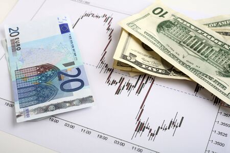 hedging: Chart of an active period of trading on the Dollar-Euro forex markets, with dollars and euro notes. Stock Photo