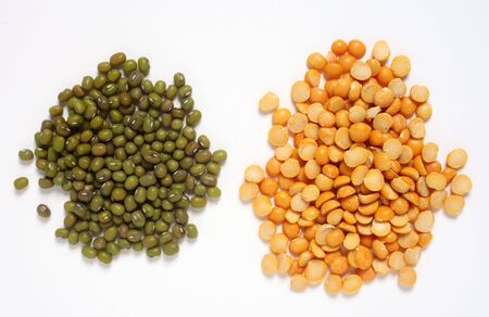 mung: Piles of mung beans (left) and split peas, two common ingredients for asian vegetarian stews (curries).