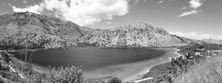 Panoramic view of Lake Kournas, Crete, the only permanent freshwater lake on the island and a popular. photo