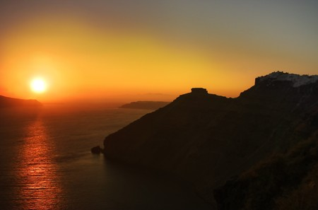 fira: A sunset on the island of Santorini, Greece, seen from the main town, Fira.