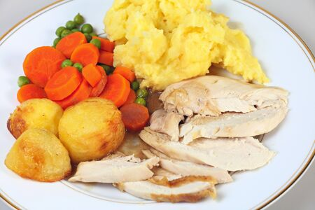 veg: A dinner of roast chicken served with roast potatoes, mixed veg, mashed potato and gravy.