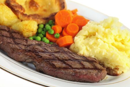 rump steak: A traditional pub-grub style British meal of rump steak, mixed veg, mashed and roasted potatoes and