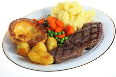 mashed potatoes: A traditional pub-grub style British meal of rump steak, mixed veg, mashed and roasted potatoes and yorkshire pudding, isolated over white