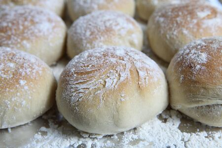 A tray of freshly baked Scottish morning rolls or baps, close-up photo
